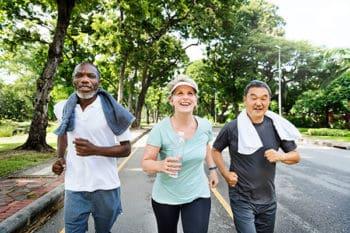 Three old people jogging